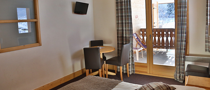 Hotel Le Cret, Morzine, France - bedroom interior with balcony.jpg